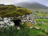 Stone Wall and Turf Roof Remnants of Saint Kilda's Main Settlement Photographic Print by Jim Richardson