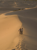 Teenagers Walk across Mesquite Dunes Near Stovepipe Wells Photographic Print by Phil Schermeister
