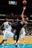 San Antonio Spurs v New Orleans Hornets: Tim Duncan and Emeka Okafor Photographic Print by Chris Graythen