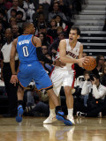 Oklahoma City Thunder v Toronto Raptors: Jose Calderon and Russell Westbrook Photographic Print by Ron Turenne
