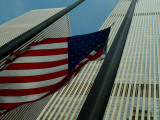 Skyward View of an American Flag Waving in Front of Skyscrapers Photographic Print by Todd Gipstein