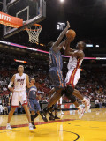 Charlotte Bobcats v Miami Heat: Chris Bosh and Nazr Mohammed Photographic Print by Mike Ehrmann