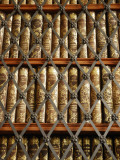 Close Up View of Antique Books Behind Caged Shelves Fotografiskt tryck av Jim Richardson