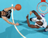 San Antonio Spurs v New Orleans Hornets: Manu Ginobili and Emeka Okafor Photographic Print by Chris Graythen