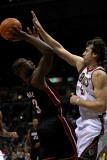 Miami Heat v Milwaukee Bucks: Dwyane Wade and Andrew Bogut Photographic Print by Jonathan Daniel