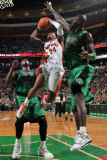 Toronto Raptors v Boston Celtics: Sonn Weems and Kevin Garnett Photographic Print by Brian Babineau