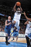 Minnesota Timberwolves v Denver Nuggets: Ty Lawson and Kevin Love Photographic Print by Garrett Ellwood