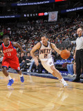 Philadelphia 76ers v New Jersey Nets: Jordan Farmar and Jrue Holiday Photographic Print by David Dow