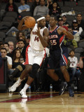 Atlanta Hawks v Toronto Raptors: Julian Wright and Jordan Crawford Photographic Print by Ron Turenne