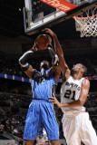 Orlando Magic v San Antonio Spurs: Dwight Howard and Tim Duncan Photographic Print by D. Clarke Evans