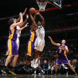 Los Angeles Lakers v Washington Wizards: Kevin Seraphin and rew Bynum and Pau Gasol Photographic Print by Ned Dishman