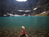 A Girl Wearing Cowboy Hat Enjoys Iceberg Lake in Glacier National Park Photographic Print by Michael Hanson