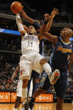 Denver Nuggets v Charlotte Bobcats: D.J. Augustin and Nene Photographic Print by Kent Smith