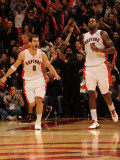 Houston Rockets v Toronto Raptors: Jose Calderon and Amir Johnson Photographic Print by Ron Turenne