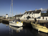Boats at a Pier by a Picturesque Cottage Photographic Print by Jim Richardson