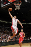 New Jersey Nets v Toronto Raptors: Linas Kleiza and Sasha Vujacic Photographic Print by Ron Turenne