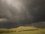 Thunderclouds Gather Above Little Missouri Grasslands and Buttes Photographic Print by Phil Schermeister