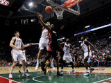 Miami Heat v Milwaukee Bucks: Andrew Bogut and Dwyane Wade Photographic Print by Jonathan Daniel