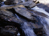 Water Cascading over Stones in the Whitewater River Photographic Print by Raymond Gehman
