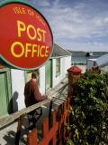 A Visitor at the Iona Island Post Office Photographic Print by Jim Richardson