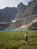 A Girl Hikes to Iceberg Lake in Montana on a Sunny Day Photographic Print by Michael Hanson