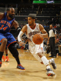 New York Knicks v Charlotte Bobcats: D.J. Augustin and Ronny Turiaf Photographic Print by Kent Smith