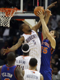New York Knicks v Charlotte Bobcats: Timofey Mozgov and Dominic McGuire Photographic Print by Streeter Lecka
