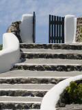 A Stone and Stucco Stairway Leading Toward a Gate Photographic Print by Richard Nowitz