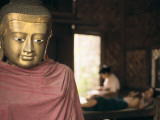 A Buddha Statue in a Woodcarver's House Photographic Print by Alison Wright