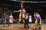 Los Angeles Lakers v Toronto Raptors: Pau Gasol and Amir Johnson Photographic Print by Ron Turenne