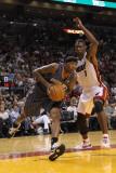 Charlotte Bobcats v Miami Heat: Tyrus Thomas and Chris Bosh Photographic Print by Mike Ehrmann