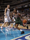 Milwaukee Bucks v Dallas Mavericks: Brandon Jennings and Dirk Nowitzki Photographic Print by Danny Bollinger