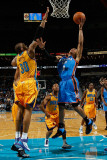 Oklahoma City Thunder v New Orleans Hornets: Russell Westbrook and David West Photographic Print by Chris