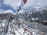 Pilgrims and Prayer Flags at Domala Pass Photographic Print by Alison Wright