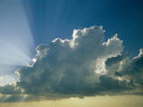 Rays of Sunlight Peek Out from Behind a Cloud Photographic Print by Jodi Cobb