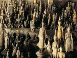 Buddhas and Other Figures in a Pak Ou Cave Photographic Print by Alison Wright