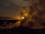 Yellowstone's Clepsydra Geyser Erupts in the Twilight Scene Photographic Print by Raymond Gehman