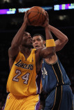 Washington Wizards v Los Angeles Lakers: Kobe Bryant and Javale McGee Photographic Print by Jeff