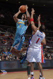 New Orleans Hornets v Detroit Pistons: Trevor Ariza and Tracy McGrady Photographic Print by Allen Einstein