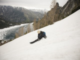 A  Climber Glissades Down a Snowfield in the Wa Backcountry Photographic Print by Michael Hanson