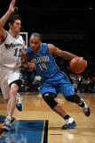 Orlando Magic v Washington Wizards: Jameer Nelson and Kirk Hinrich Photographic Print by Ned Dishman