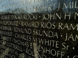 Close View of Names Etched into the Vietnam Memorial Photographic Print by Todd Gipstein