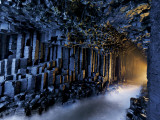 Basalt pillars line Fingal's Cave. Photographic Print by Jim Richardson