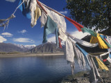 Prayer Flags Along the Yarlung Tsangpo (Brahmaputra) River Photographic Print by Alison Wright