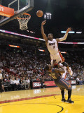 Charlotte Bobcats v Miami Heat: Dwyane Wade and Sherron Collins Photographic Print by Mike Ehrmann