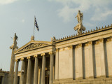 Afternoon Sunlight on the Gilded Academy of Athens with a Greek Flag Photographic Print by Richard Nowitz