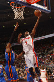 New York Knicks v Detroit Pistons: Rodney Stuckey and Amar'e Stoudemire Photographic Print by Allen Einstein