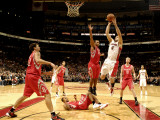 Houston Rockets v Toronto Raptors: Linas Kleiza and Chuck Hayes Photographic Print by Ron Turenne