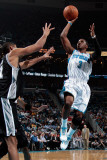 San Antonio Spurs v New Orleans Hornets: Chris Paul and Tim Duncan Photographic Print by Chris Graythen