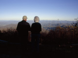 An Old Couple Taking in a Scenic View from Wayah Bald at Dusk Photographic Print by Raymond Gehman